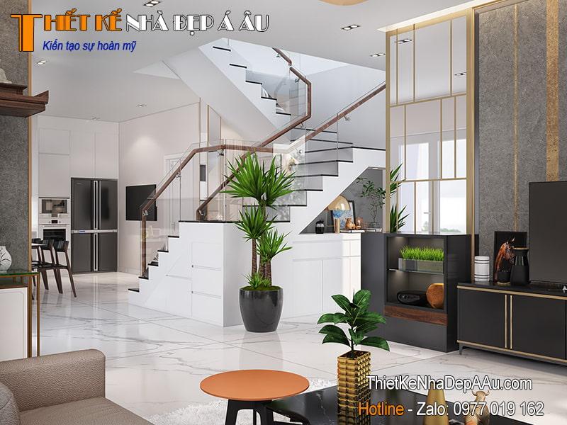 Mẫu cầu thang hiện đại đặt giữa phòng khách và phòng bếp